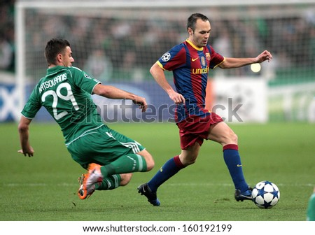 ATHENS, GREECE - NOV 24 : Katsouranis of Panathinaikos (L) in action with Iniesta of Barcelona (R) during the Champions League group Panathinaikos vs Barcelona on November 24, 2010 in Athens, Greece - stock photo