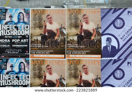 ATHENS, GREECE - OCTOBER 15, 2014: Wall with live music concert posters indie rock by Morrissey and dj sets of minimal techno by Ray Okpara and psychedelic trance by Infected Mushroom. - stock photo