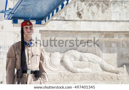 ATHENS, GREECE - SEPTEMBER 30, 2016: Soldier guards the Tomb of the Unknown Soldier at Syntagma Square, Athens, Greece