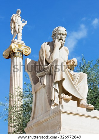 Athens - The statue of Socrates in front of National Academy building by the Italian sculptor Piccarelli (from 19. cent.) and the Apollo statue on the Background. - stock photo