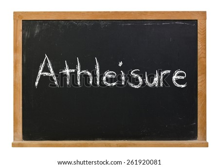 Athleisure written in white chalk on a black chalkboard isolated on white - stock photo