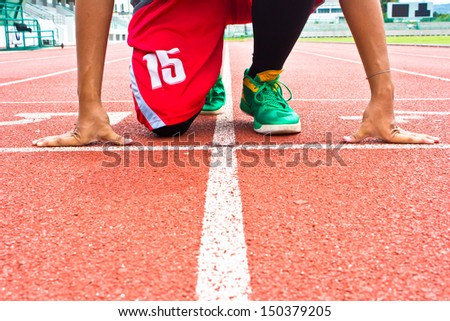 athlete at the start line of the stadium  - stock photo