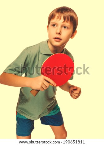 athlete boy child teenager with racket plays table tennis ping pong isolated on white background cross processing retro - stock photo
