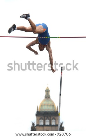 Athlete clearing the bar during a pole vault event in Prague, Czech Republic (some noise) - stock photo
