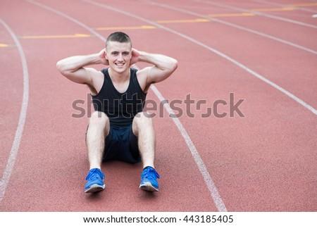 athlete doing sit-ups - stock photo