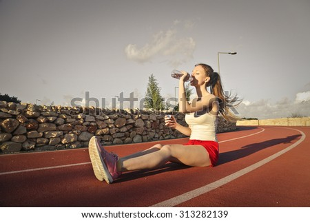 Athlete drinking - stock photo