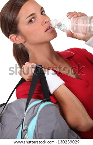 Athlete drinking water - stock photo