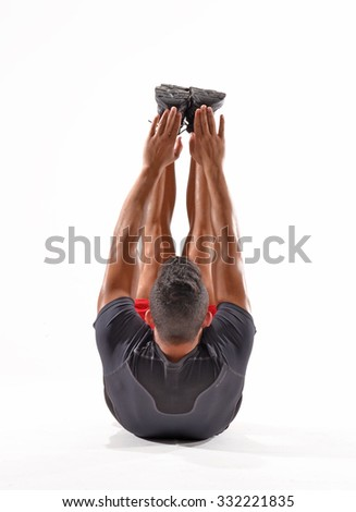 Athlete fitness man stretching legs and arms on white background. - stock photo