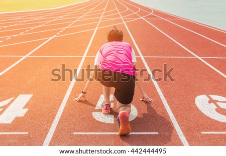 athlete getting ready to start on running  track in the stadium.  - stock photo