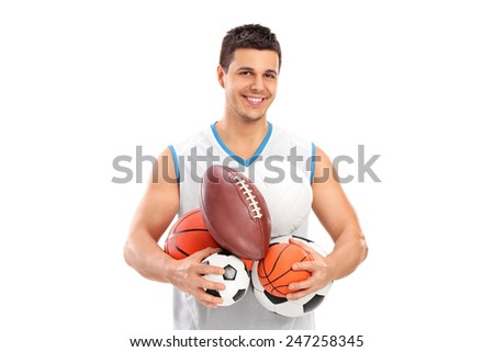 Athlete holding a bunch of different kinds of balls isolated on white background - stock photo