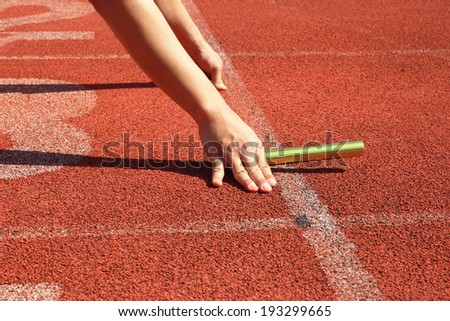 Athlete in the starting blocks, ready to go - stock photo