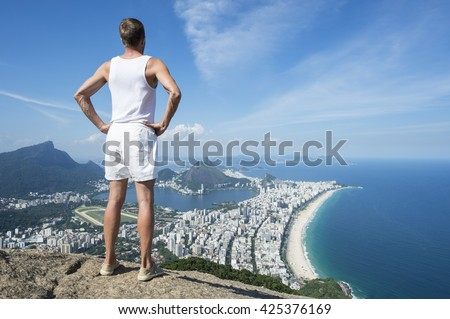 Athlete in vintage white uniform standing at an overlook view of the Rio de Janeiro Brazil skyline - stock photo