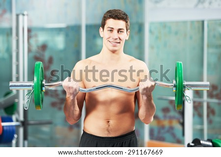 athlete man workout biceps brachii muscles exercises with training weight in fitness gym - stock photo