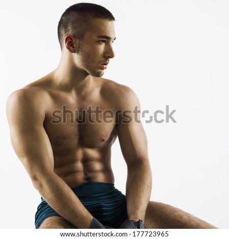 Athlete men sitting - stock photo