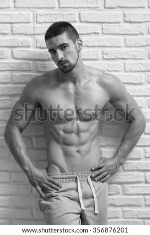 Athlete Muscular Bodybuilder Emotional Posing At The Wall
