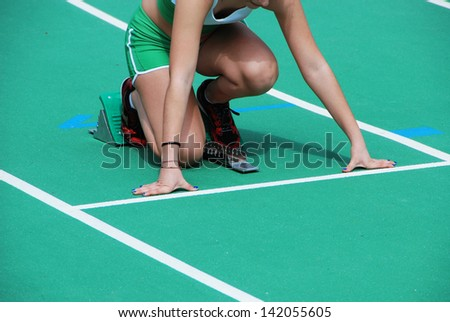 Athlete on starting blocks - stock photo