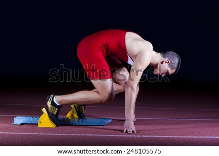 athlete on the starting block - stock photo