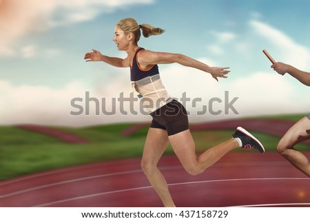 Athlete passing a baton to the partner against digital image of athletic track - stock photo