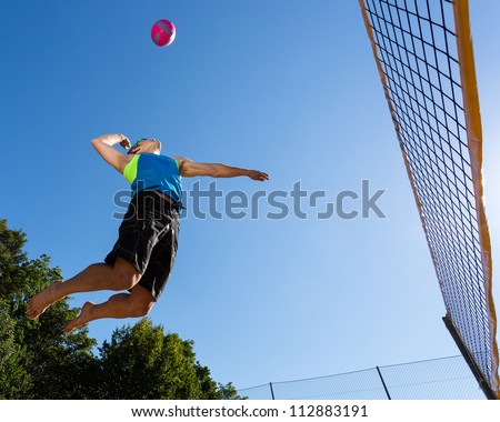 athlete playing beachvolleyball - stock photo