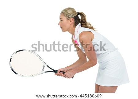 Athlete playing tennis with a racket on white background