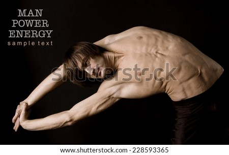 Athlete.Power.Energy.Gym.Men's sports figure on a black background.exercise.Sepia - stock photo