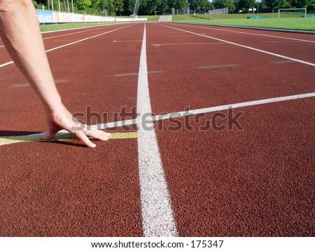 Athlete ready to stat - stock photo