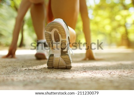 Athlete runner feet running on treadmill closeup on shoe.Female fitness with open space around  - stock photo