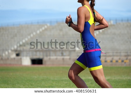 Athlete runner running on athletic track - stock photo