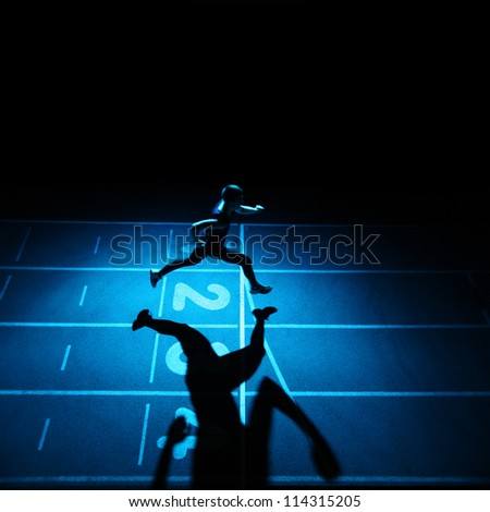 Athlete running on blue running track - stock photo