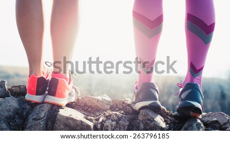 athlete running sport feet on trail healthy lifestyle fitness - stock photo