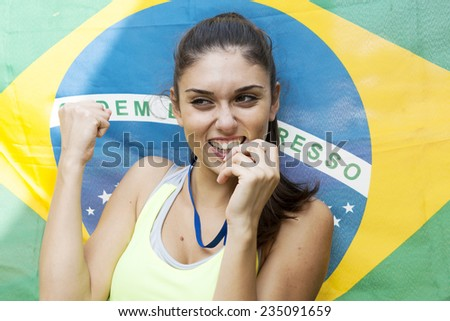 athlete shows the gold medal winner - stock photo