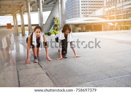 Athlete Sport Woman In Running Start Pose On The City Street Tight Clothes