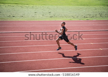 Athlete sprinting on the running track