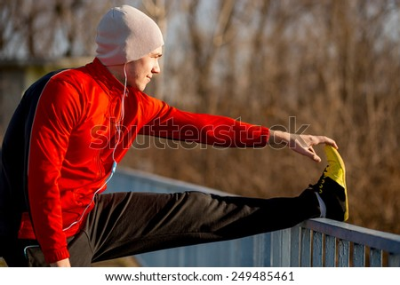Athlete stretching out before jogging - stock photo