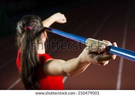 athlete throwing javelin - stock photo