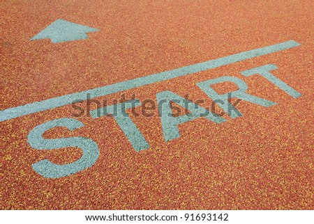 Athlete track start sign with arrow - stock photo