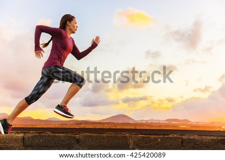 Athlete trail running silhouette of a woman runner at sunset sunrise. Cardio fitness training of marathon race sportswoman. Active healthy lifestyle in summer nature outdoors. - stock photo