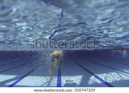 athlete training swimming
