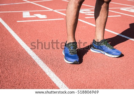 Athlete waiting start on a running track