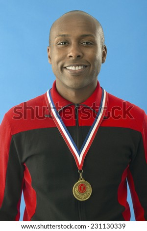 Athlete With Gold Medal - stock photo