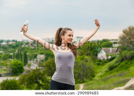 Athlete woman refreshing with Bottle of water after running workout outdoors. Woman Enjoying nature, Healthy active Lifestyle - stock photo