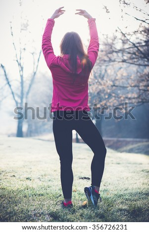 Athlete woman stretching outdoor. Healthy lifestyle concept. - stock photo