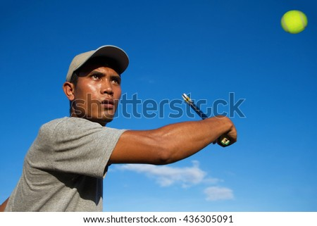 Athlete young Man player tennis With sky blue - Sport Concept - stock photo