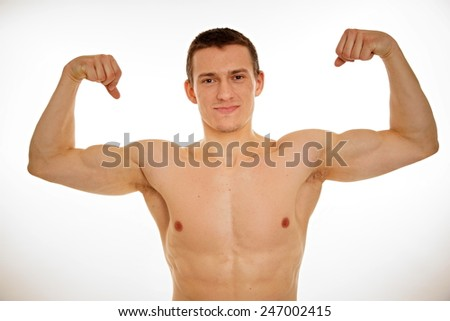 Athlete young man with no shirt shows his biceps