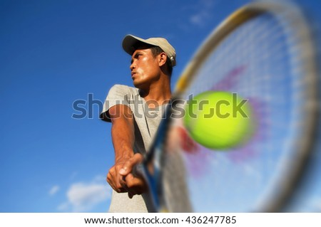 Athlete young men player tennis With sky blue - Sport Concept - stock photo