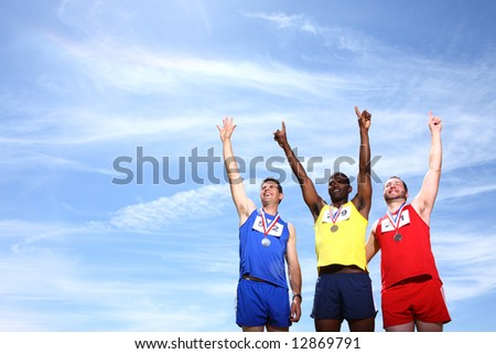 Athletes with medals - stock photo