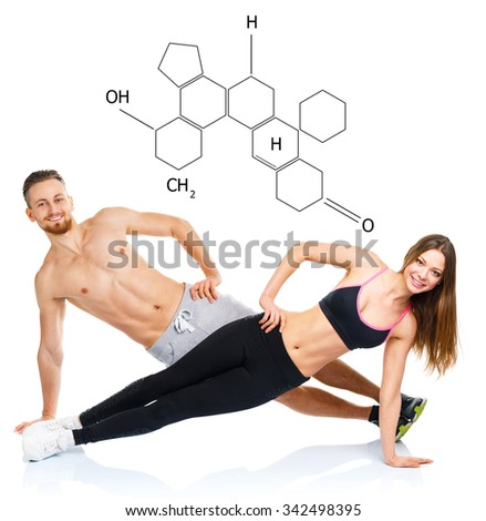 Athletic attractive couple - man and woman doing fitness exercises on the white with the chemical formula on background - concept of healthy life - stock photo