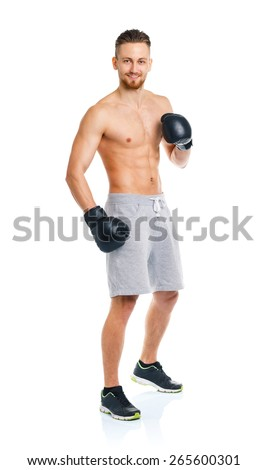 Athletic attractive man wearing boxing gloves on the white background
