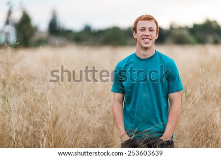 Athletic Attractive Young Male Outside in field - stock photo
