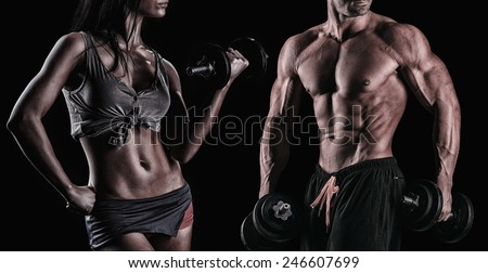 athletic beautiful sexy young couple posing in studio - stock photo